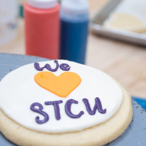 An photograph of a frosted STCU cookie created by Sweet Frostings Blissful Bakeshop.