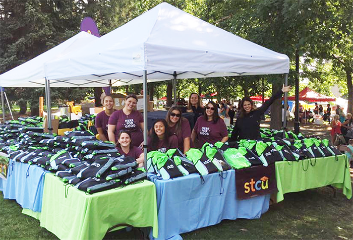 Photo of school supplies STCU tent at Unity in the Community.